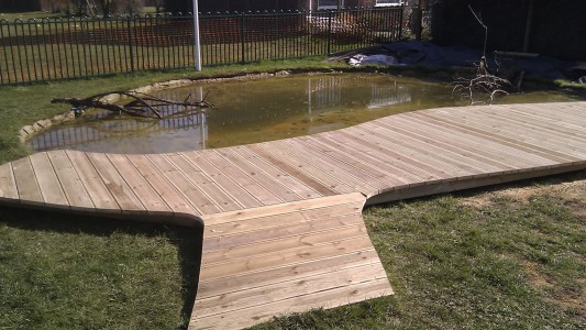 school deck and pond