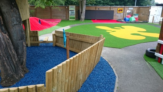 Outdoor blackboards, mirrors, fun soft play surfacing, tunnels and mounds
